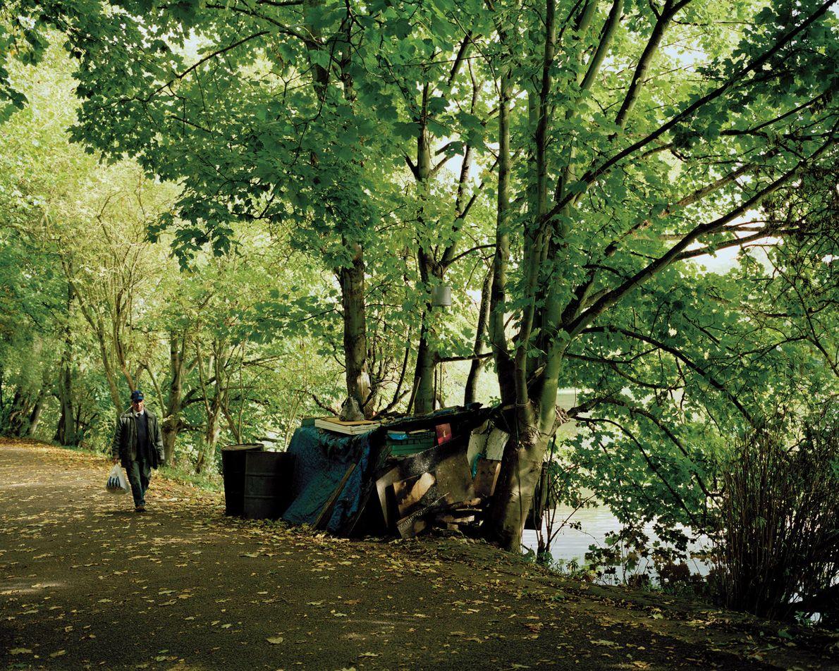 Twickenham, London: a riverside encampment next to a makeshift raft house. The occupant is said to ...