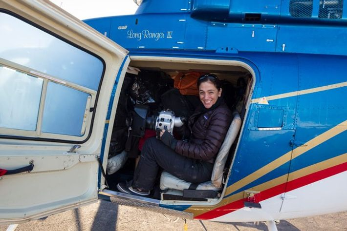 Photographer and marine scientist Cristina Mittermeier looks out from a helicopter