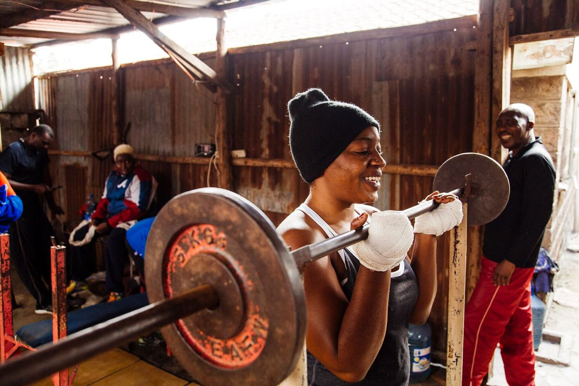 """A training session in boxer Ken Ochieng's gym in Komarock Estate, Nairobi. Louis Nderi: """"When I first arrived to ..."""