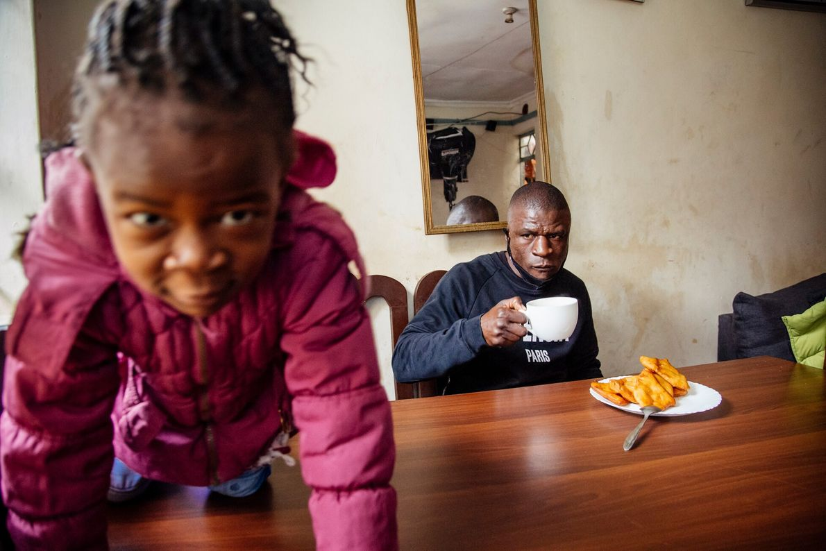 """Onyango at home with his daughter. Louis Nderi: """"The impact of COVID-19 has been significant, particularly ..."""