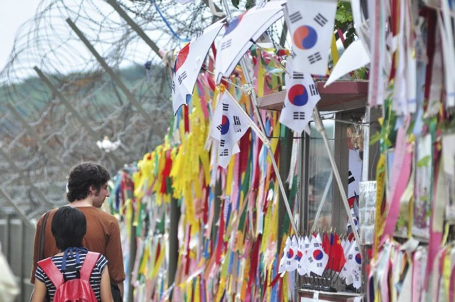 Prayer ribbons tied to the fence between North and South Korea.