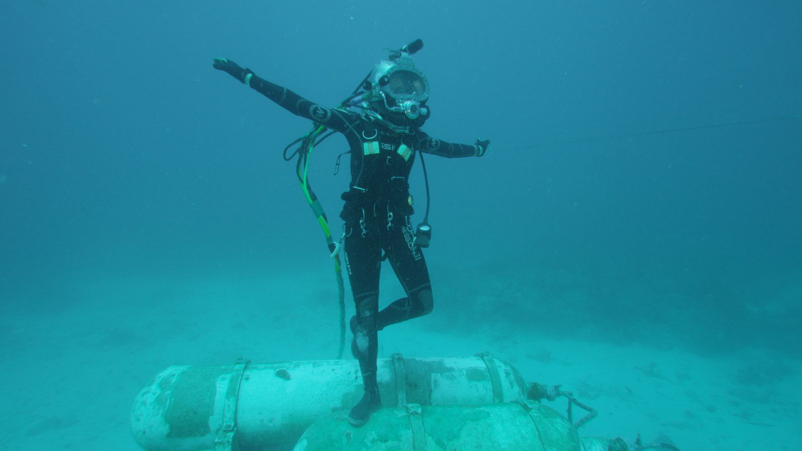 Grace dances outside Aquarius, her underwater home for 15 days during Mission 31. Photo: Fabien Cousteau ...