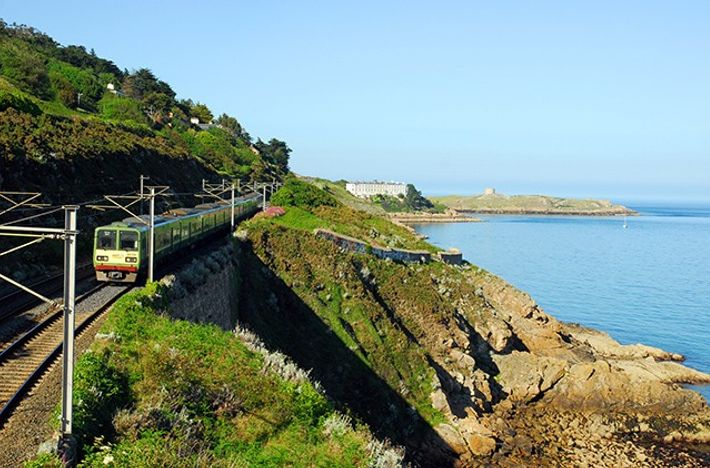 A DART suburban train passes Killiney Bay in Co. Dublin.