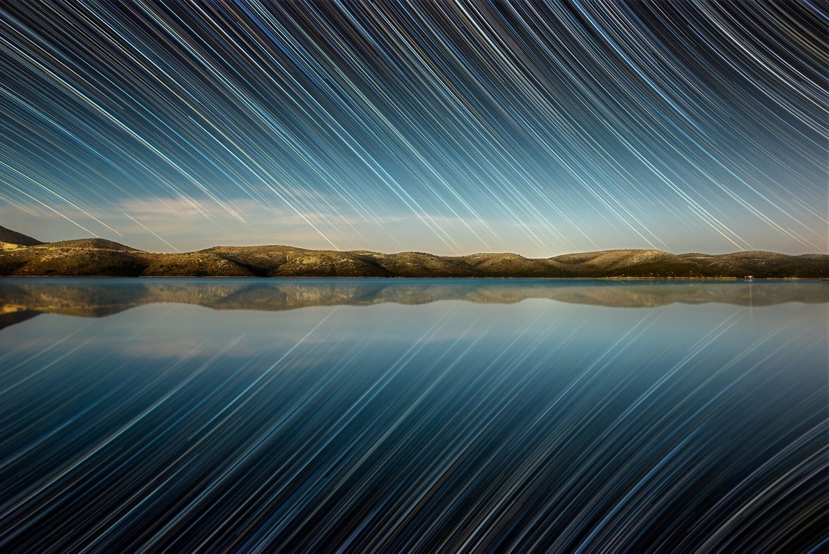 A star trails image created using 247 25-second exposures over the lake of Dugi Otok, in ...