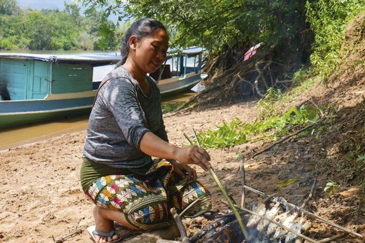 Preparing fish on bamboo spears. Image: Audrey Gillan