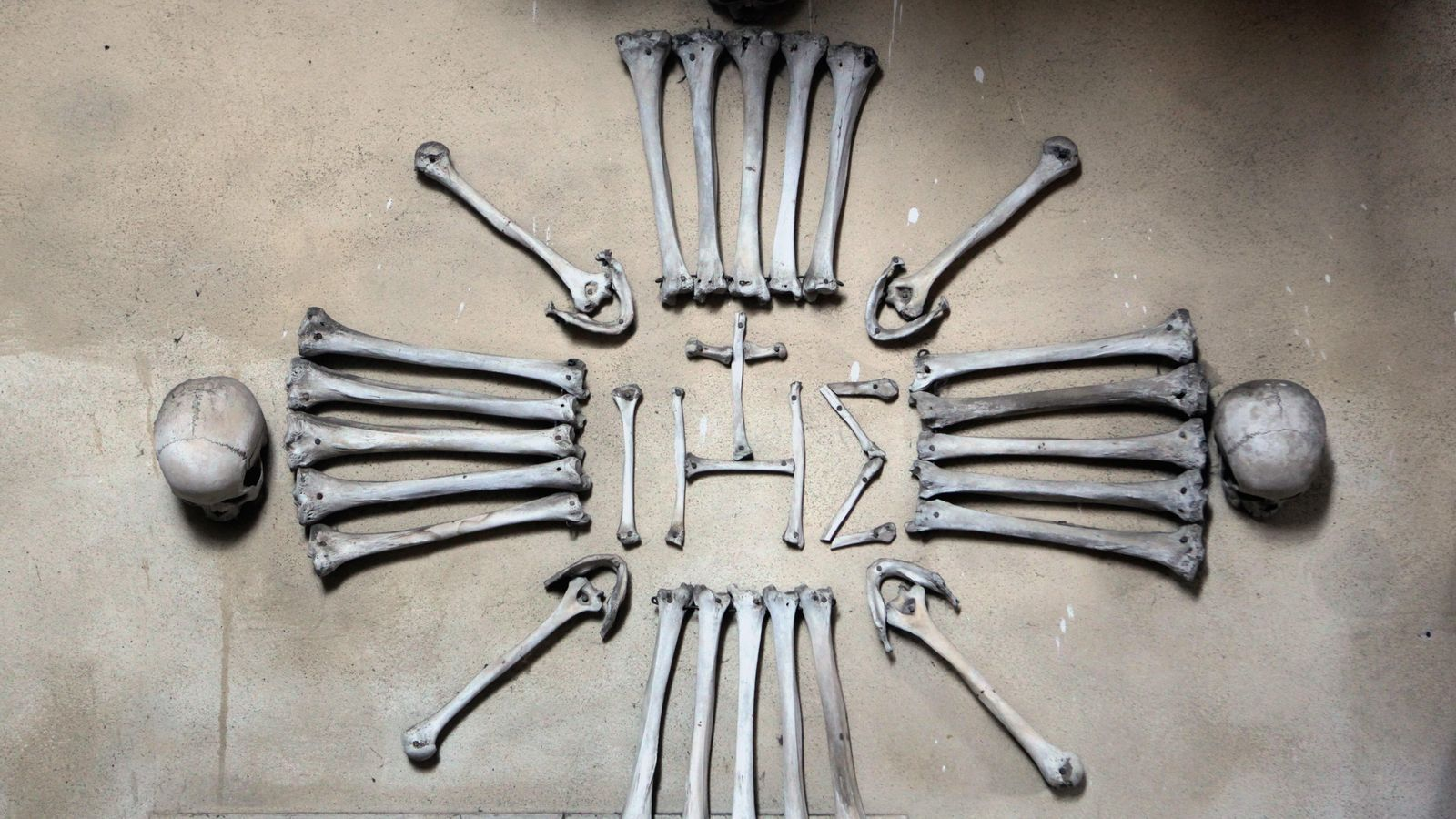 A Christogram – an archaic abbreviation for the name of Christ– made of human bones and ...