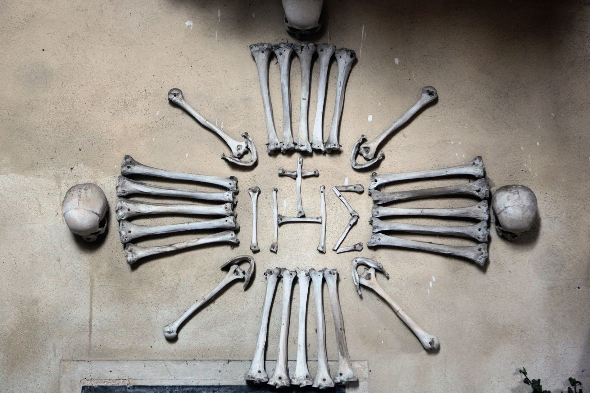 A Christogram – an archaic abbreviation for the name of Christ – made of human bones and ...