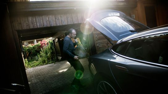 A Norwegian man loads his Tesla S for a trip to his cabin for the weekend. ...