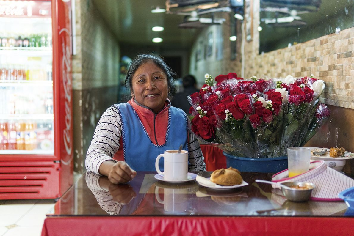 A flower seller enjoying hot chocolate with cheese.