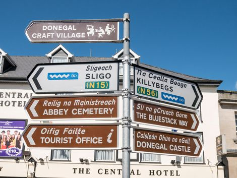 Bilingual road signs in Donegal, Ireland.