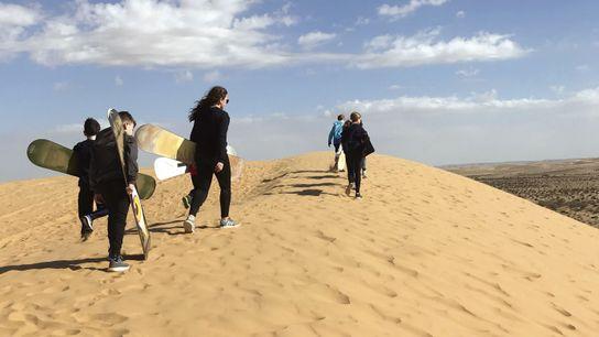 Sand dune surfing at Dror Bamidbar