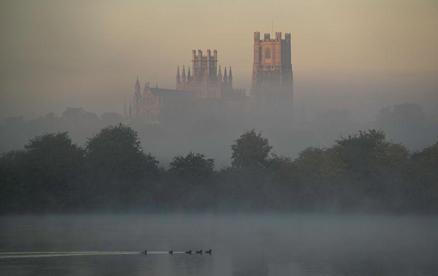 The gigantic Ely cathedral rises from the flatlands of the Cambridgeshire Fens like a galleon – ...