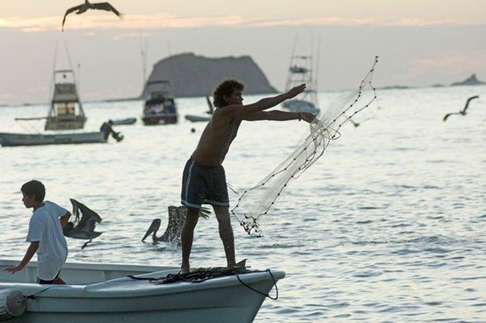 Fisherman at Carrillo Beach, farm to table in Costa Rica