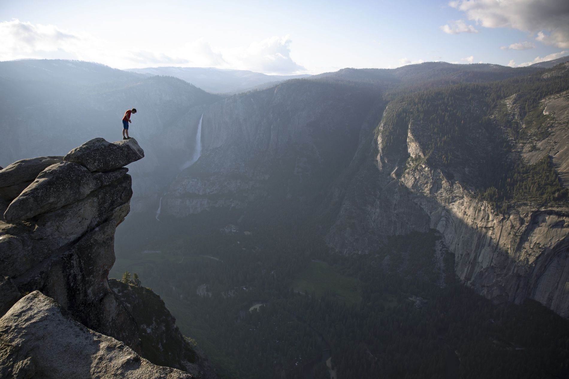 Don't look down... at least until you're at the top. Alex Honnold peers over the edge of Glacier Point in Yosemite National Park. He had just climbed 650 metres up from the valley floor.