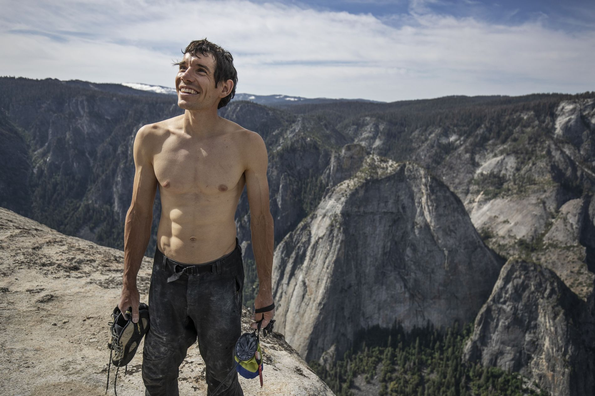 Alex Honnold holds all of his climbing gear atop the summit of El Capitan. He had just became the first person to climb El Capitan without a rope.