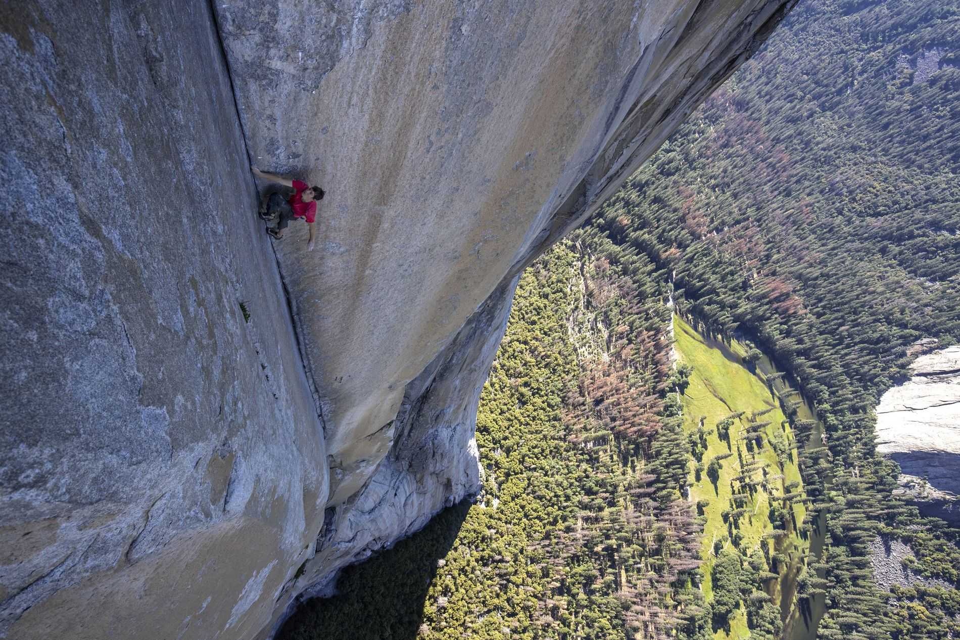 Without ropes, bolts or protection, Alex Honnold is at the mercy of his own ability. One false move would be fatal. Here he climbs through the enduro corner on El Capitan's Freerider.