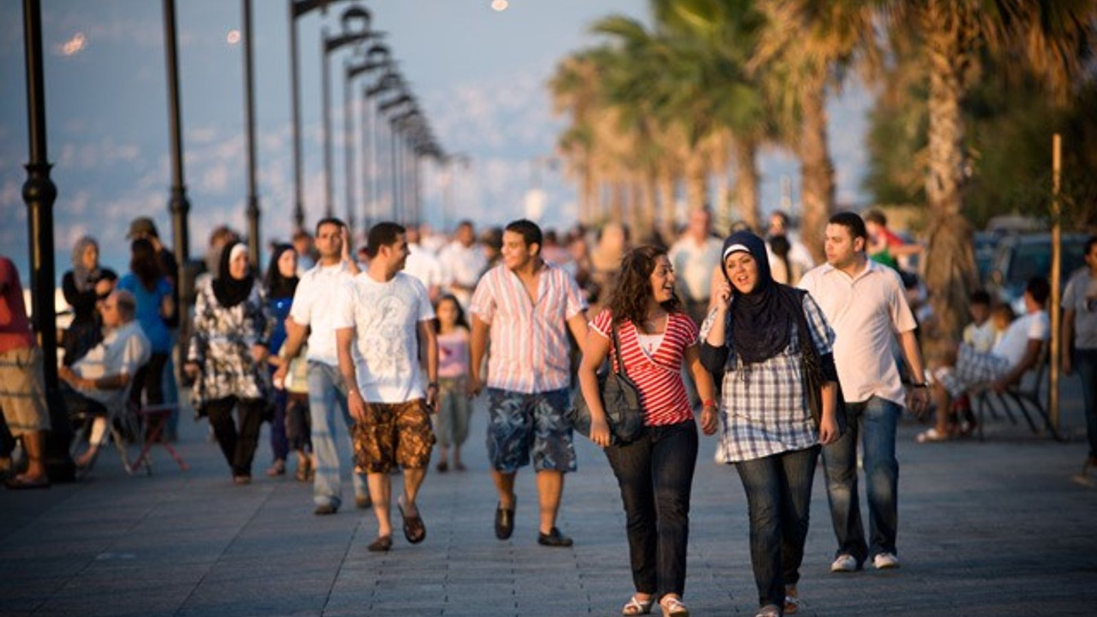 Crowds walk along the Corniche during late afternoon, Beirut, Lebanon.