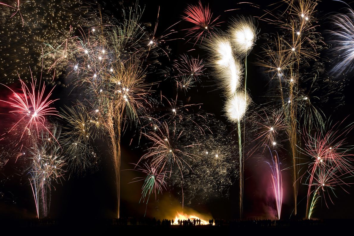 Bonfire Night fireworks illuminate the sky in the village of Slingsby in Northeast England, as a ...