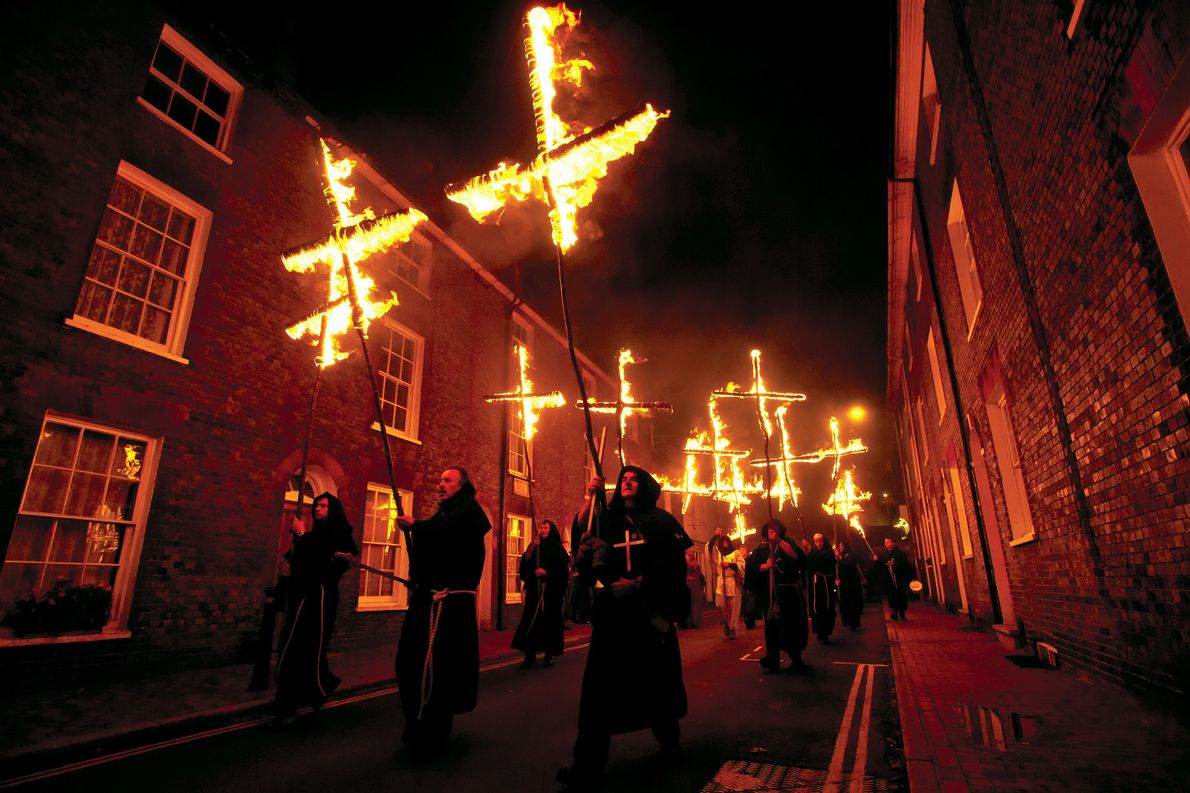 In a Bonfire Night celebration in Lewes, England, participants march with burning crosses to commemorate the ...