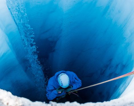 Descending into the 'blue of time' of a glacier in Kulusuk, Greenland.