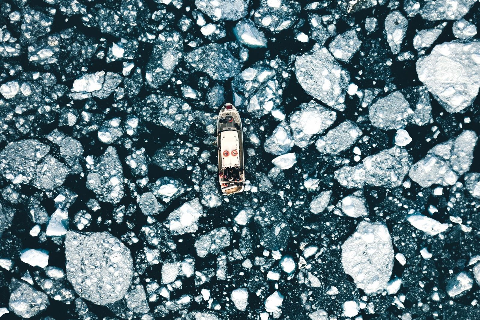 """Stian Klo: """"Our boat in the midst of the ice breaking off from the active Eqi ..."""