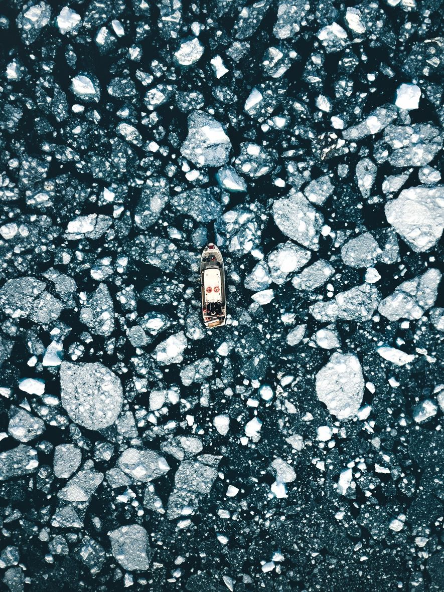 "Stian Klo: ""Our boat in the midst of the ice breaking off from the active Eqi ..."