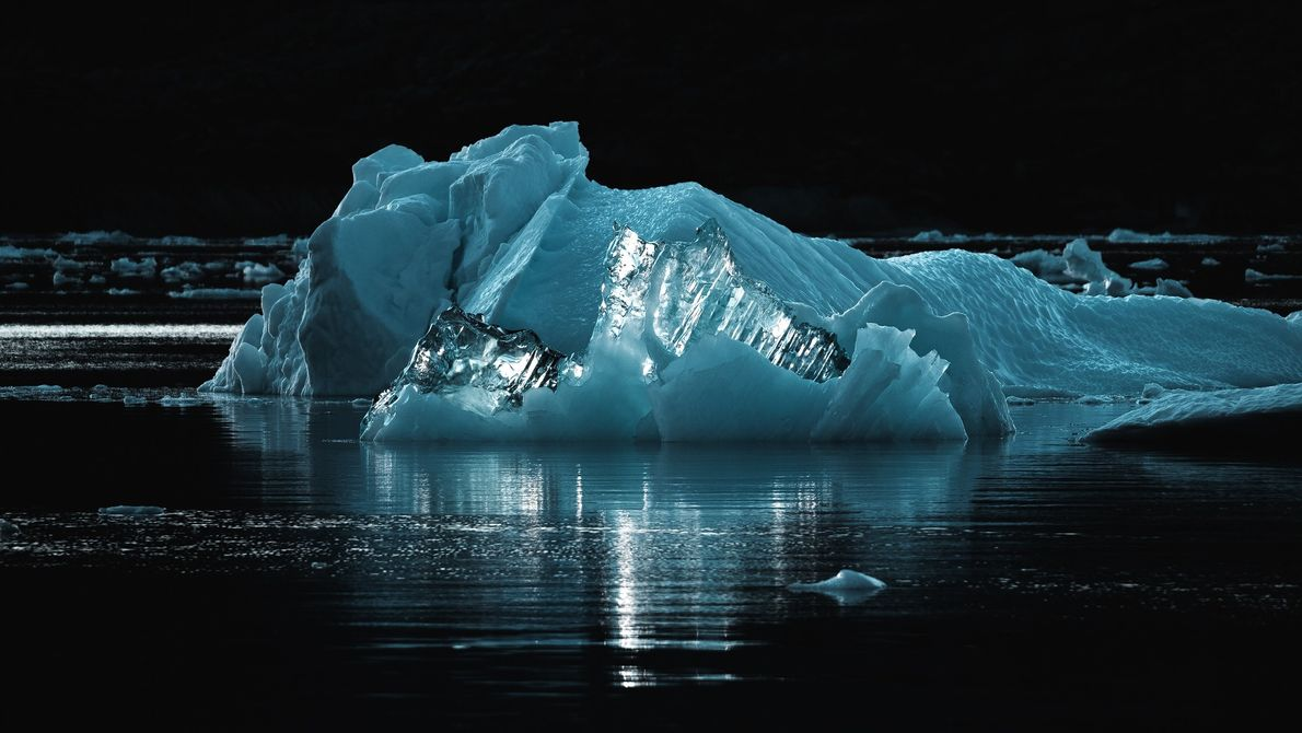 """The famous blue ice perfectly backlit by the sun. It's very diamond-like in its appearance."""