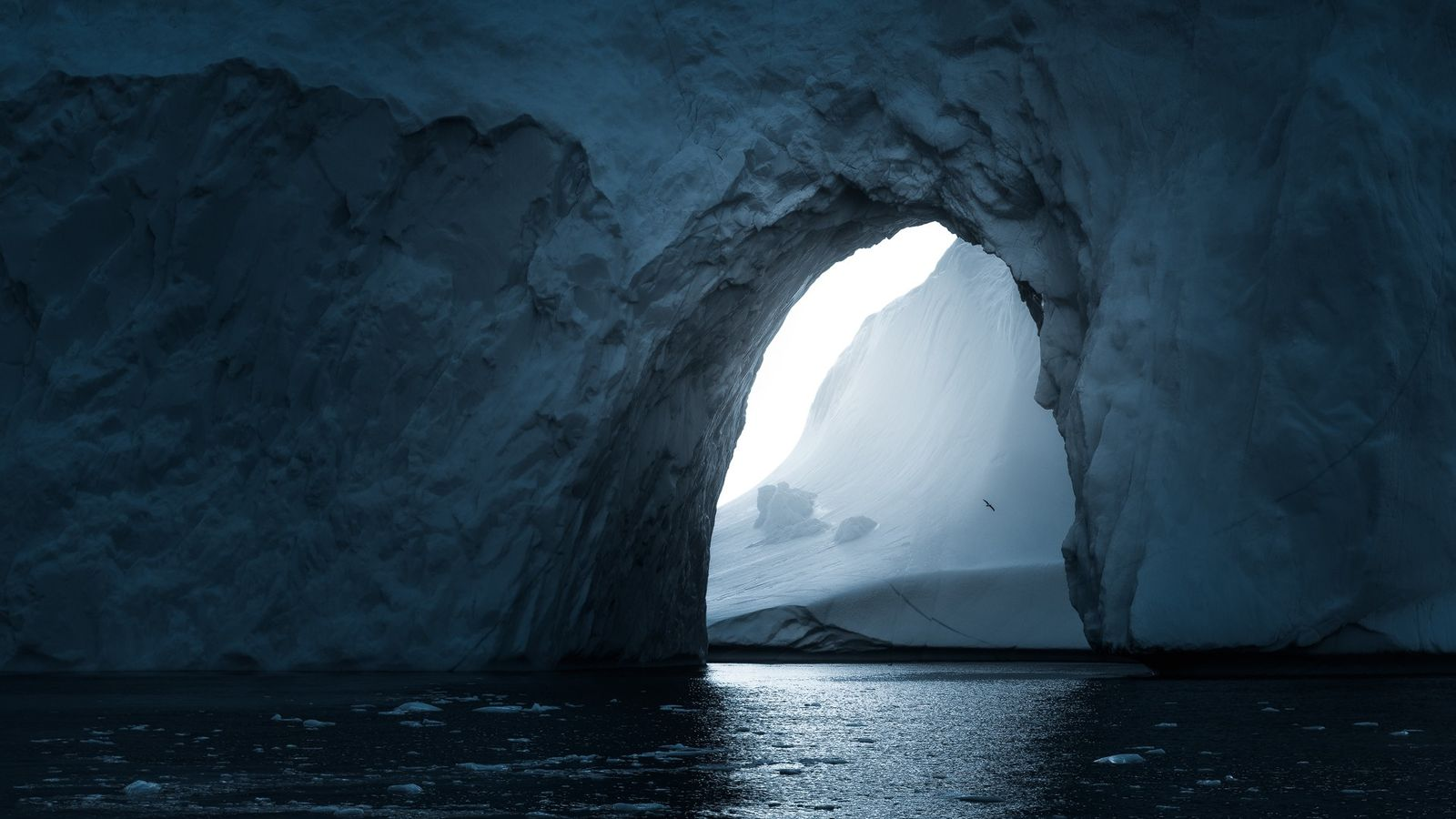 """Stian Klo: """"This is an arch in the iceberg I'd photographed earlier with my drone – ..."""