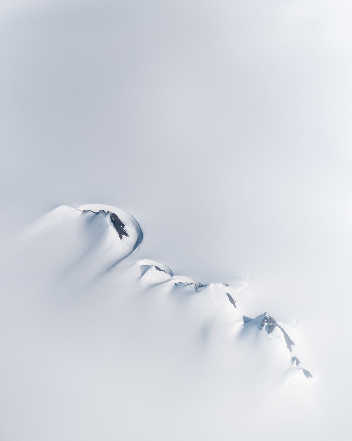 "Nunataks – mountaintops protruding above the ice sheet – visible from a plane. Stian Klo: ""This ..."