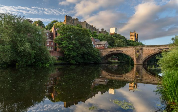 Looking up at Durham Castle and Cathedral from the west bank of the Wear, near Framwellgate ...