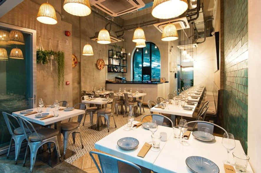 Whitewashed interior of Catch, one of Hong Kong's hippest restaurants.