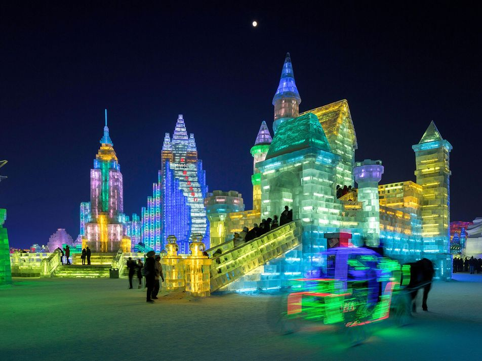 Watch This Ice City Come Alive with Colorful Lights