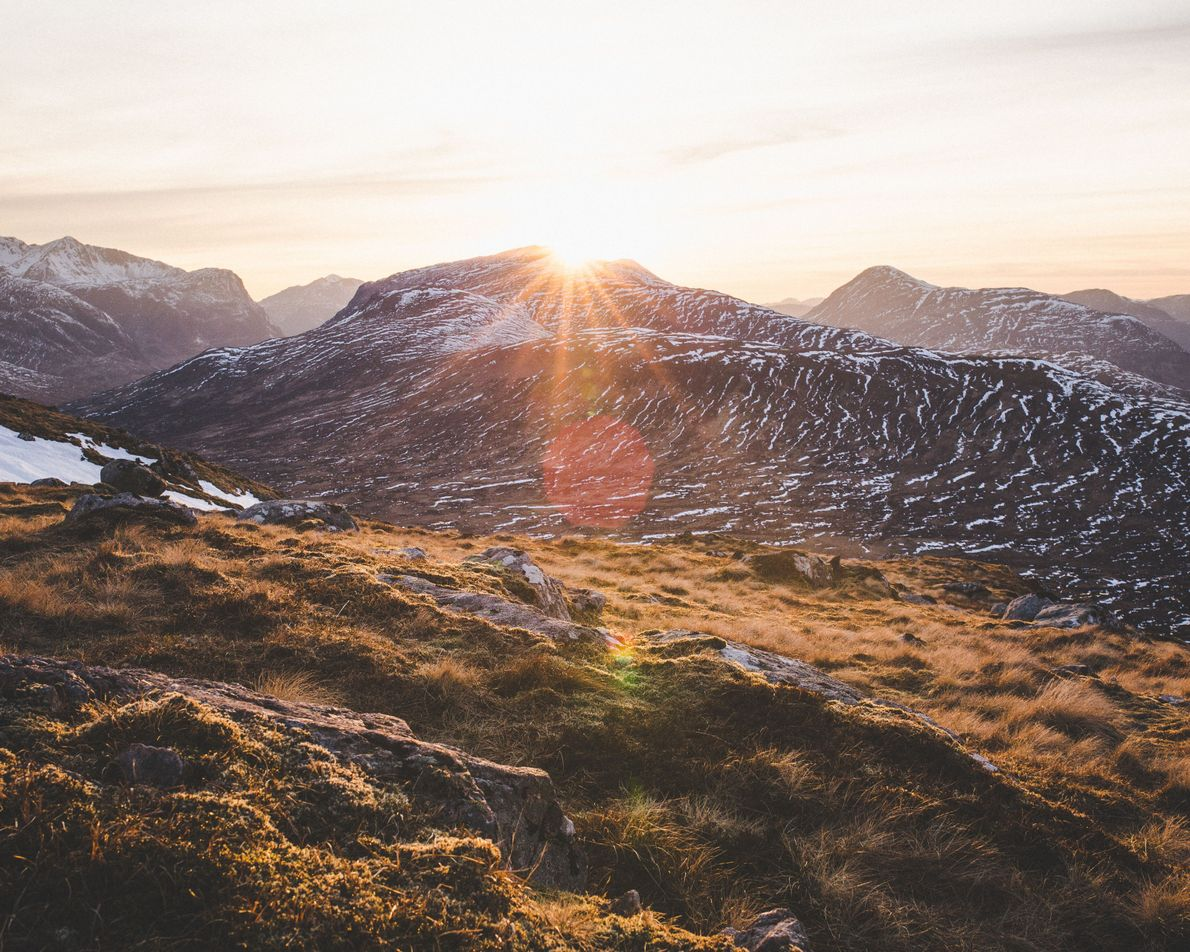 The sun sets above the highest point of the Devil's Staircase – the steepest section of ...