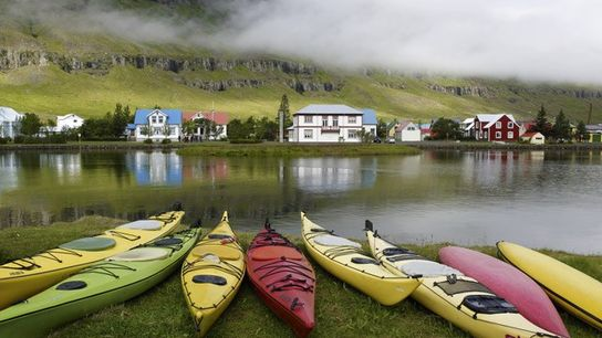 Kayaks on the shore of fjord, Seydisfjordur