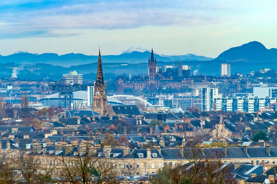 Looking over the fusion of styles that is modern Glasgow with the Lomond Hills beyond, from ...