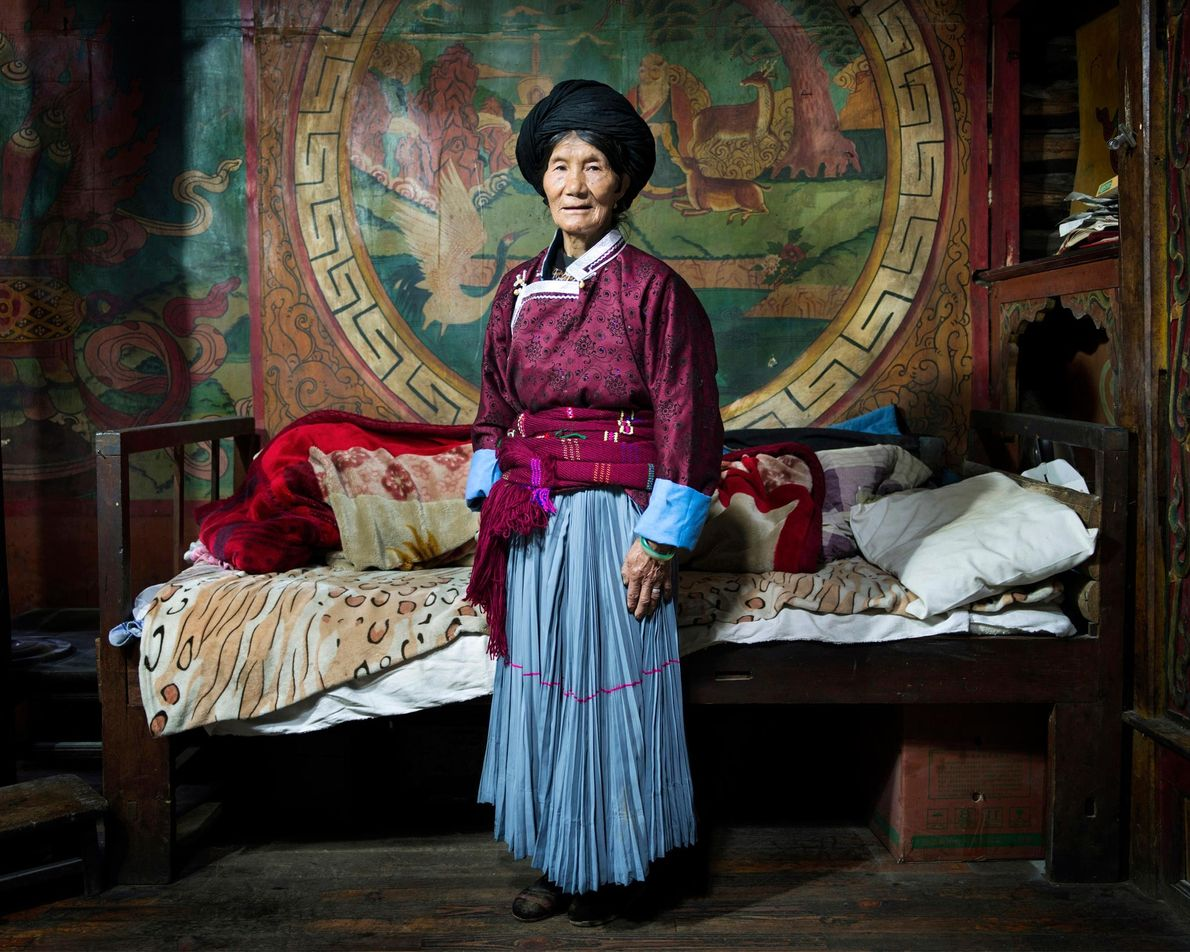 Libi Lamu, 70, stands in her bedroom in the village Bushucun. In Mosuo tradition the bedroom ...