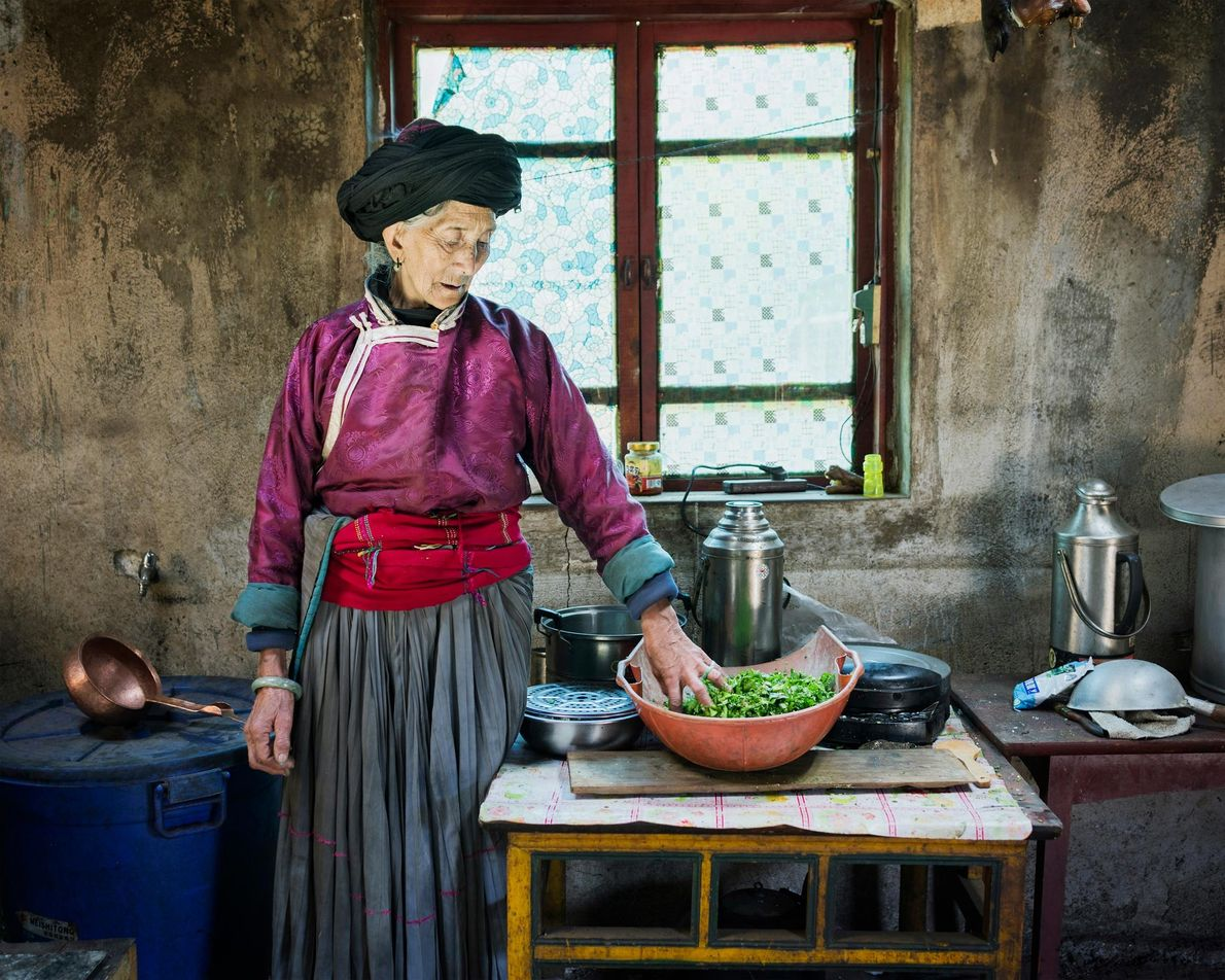 Geiku Dorma, 77, stands in her home. She makes ends meet through her region's burgeoning tourism ...