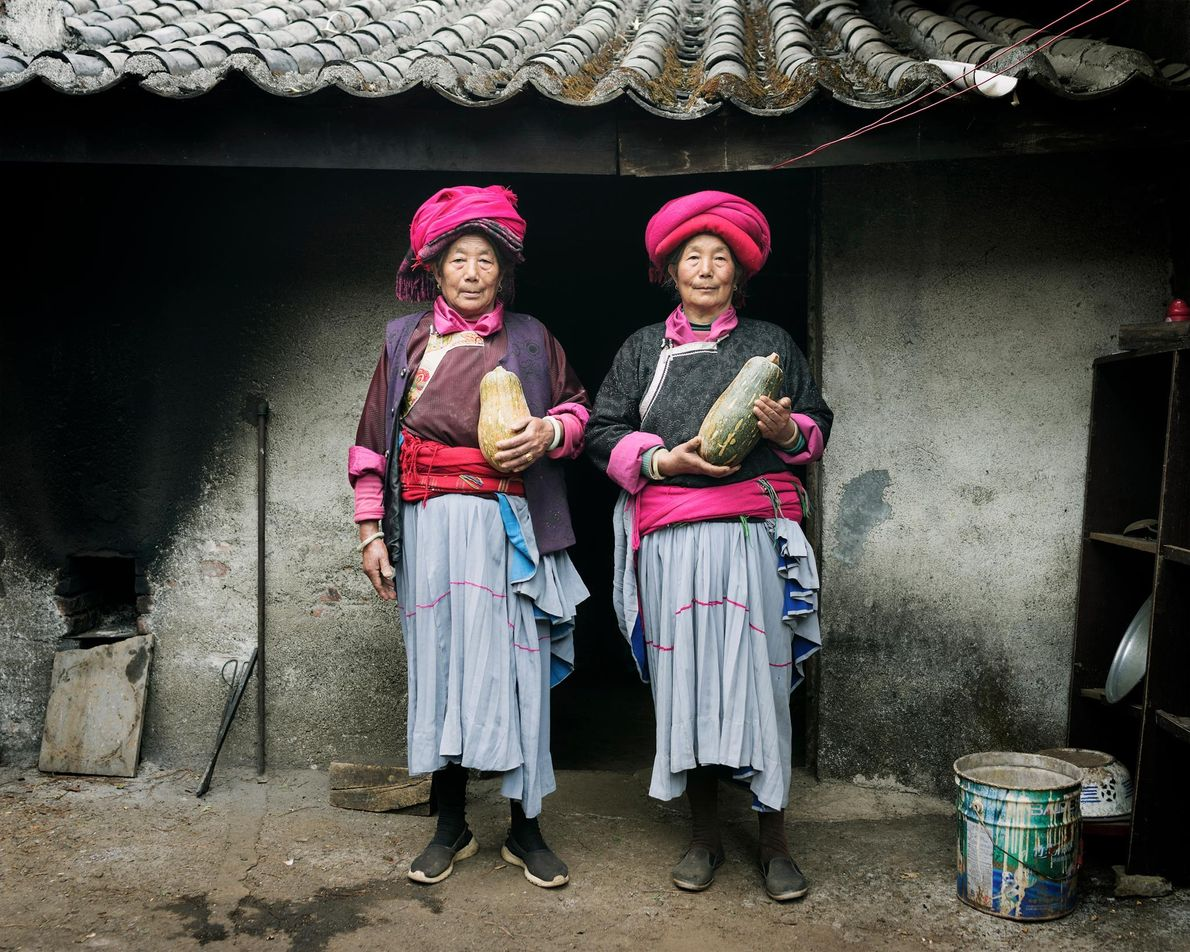 Naju Dorma, 73, and Lacuo Dorma, 66, from the village of Luoshui, don traditional Mosuo clothing.
