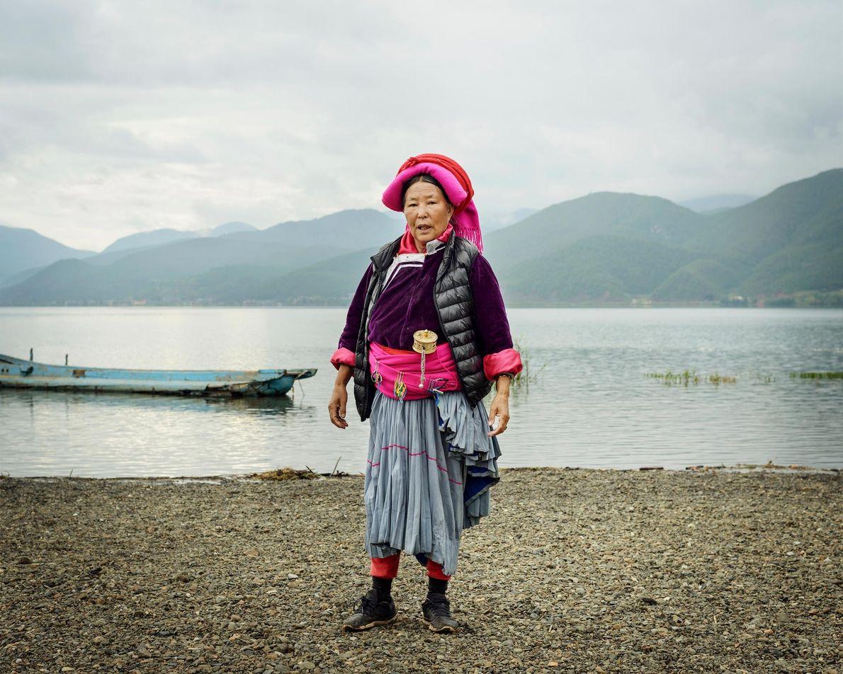 Dashi Lamu, 72, visits the bank of Lugu Lake near her village of Luoshui. Every morning, ...