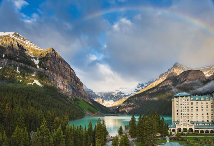Lake Louise and Victoria Glacier at sunrise with The Fairmont Chateau Lake Louise at the foreground.