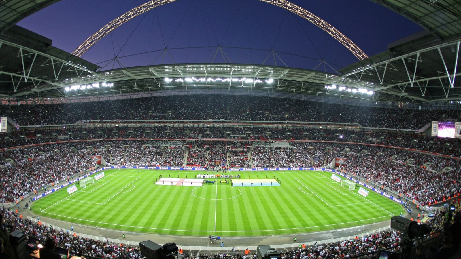 Wembley Stadium hosts a night time qualifying game for the World Cup.