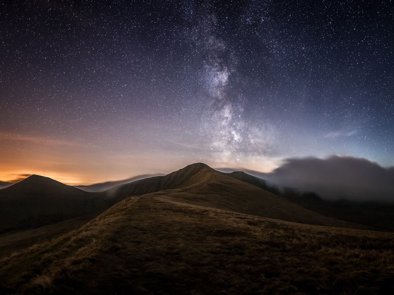 """Alyn Wallace: """"The Milky Way above the central Brecon Beacons with Pen-y-Fan (886m), the highest peak ..."""
