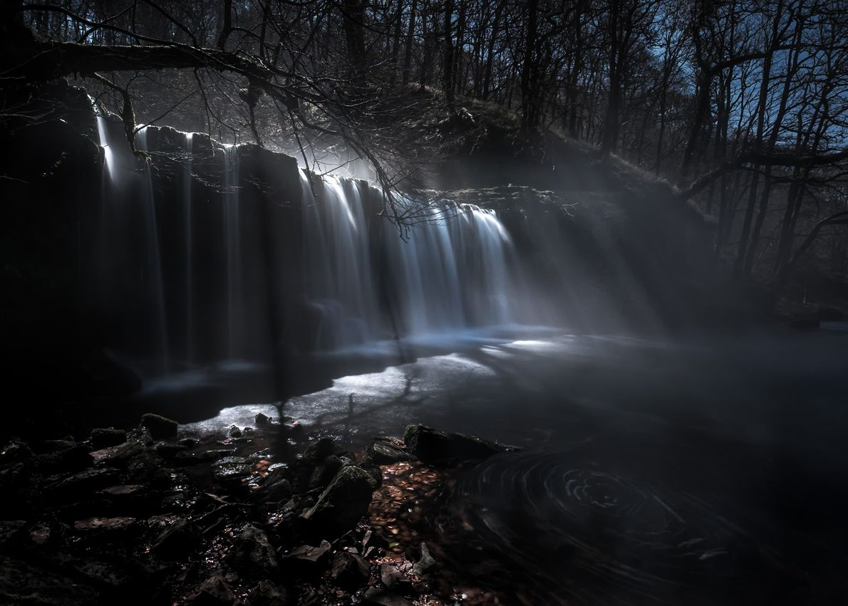 Rays of moonlight spectrally illuminate the waterfall of Sgwd Ddwli in the Brecon Beacons. Alyn Wallace: ...