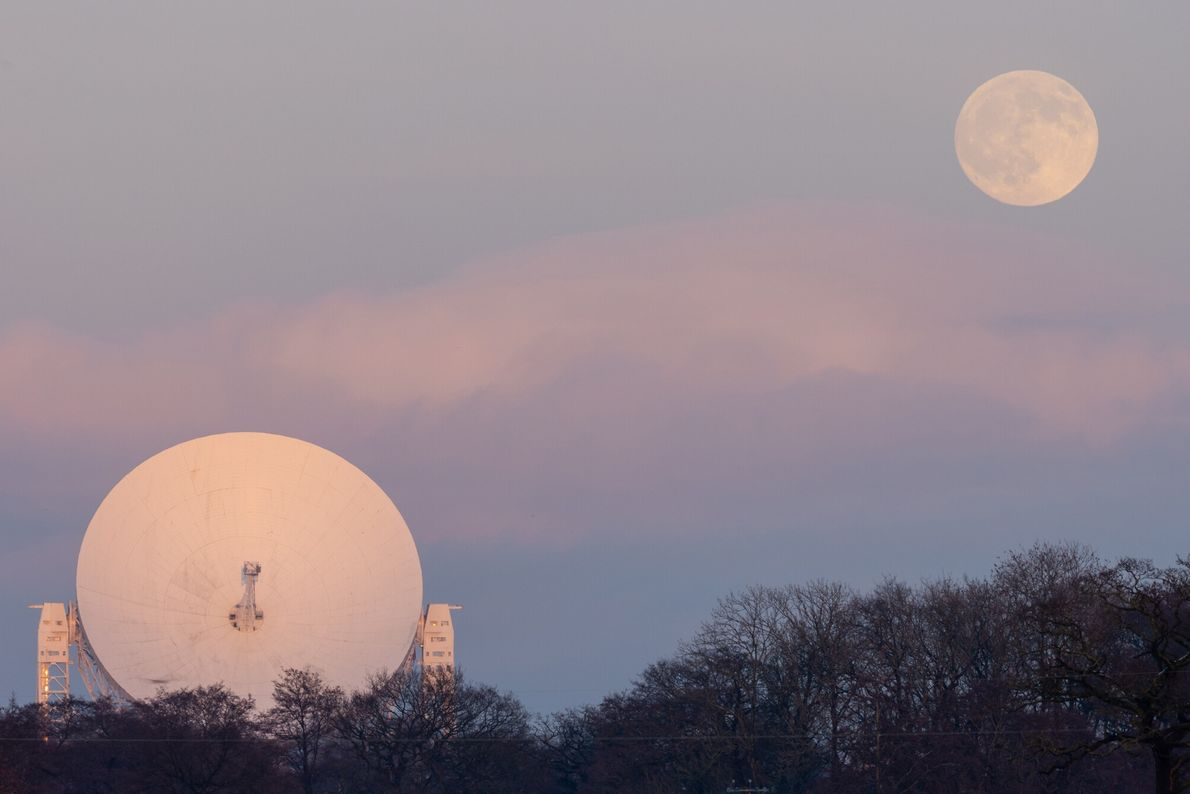 Compressed on a 400mm telephoto lens, this shot of the Lovell Telescope in Cheshire and the ...