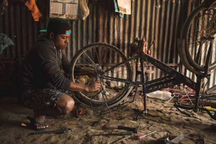 Magar modifies his first mountain bike from old bicycle and motorcycle parts