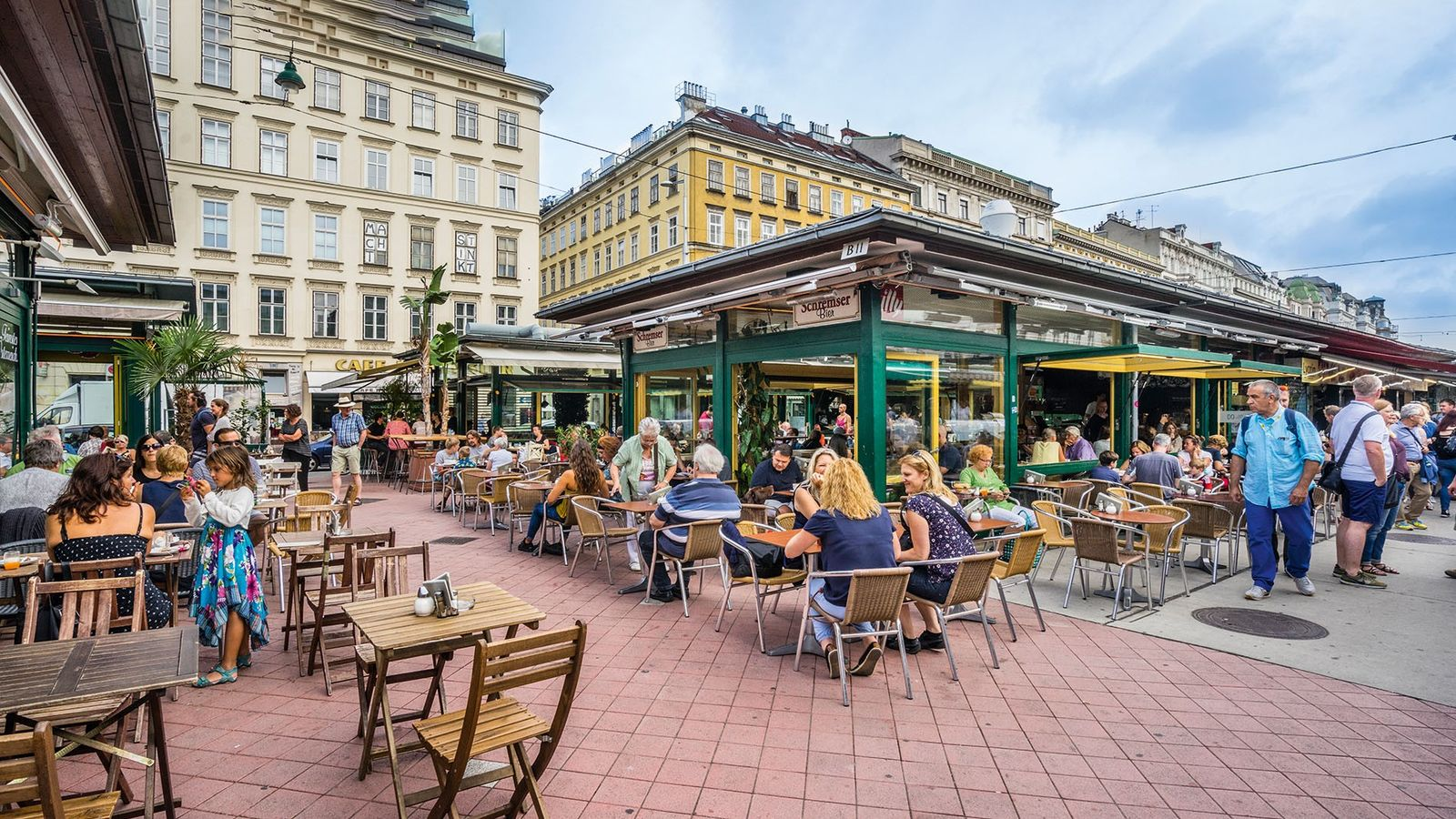 Diners and drinkers at Vienna's Naschmarkt.