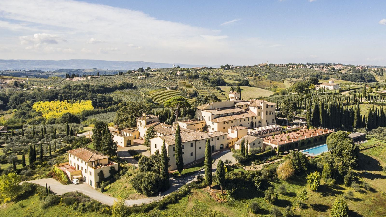 Aerial view of Castello del Nero Hotel and Spa in the countryside