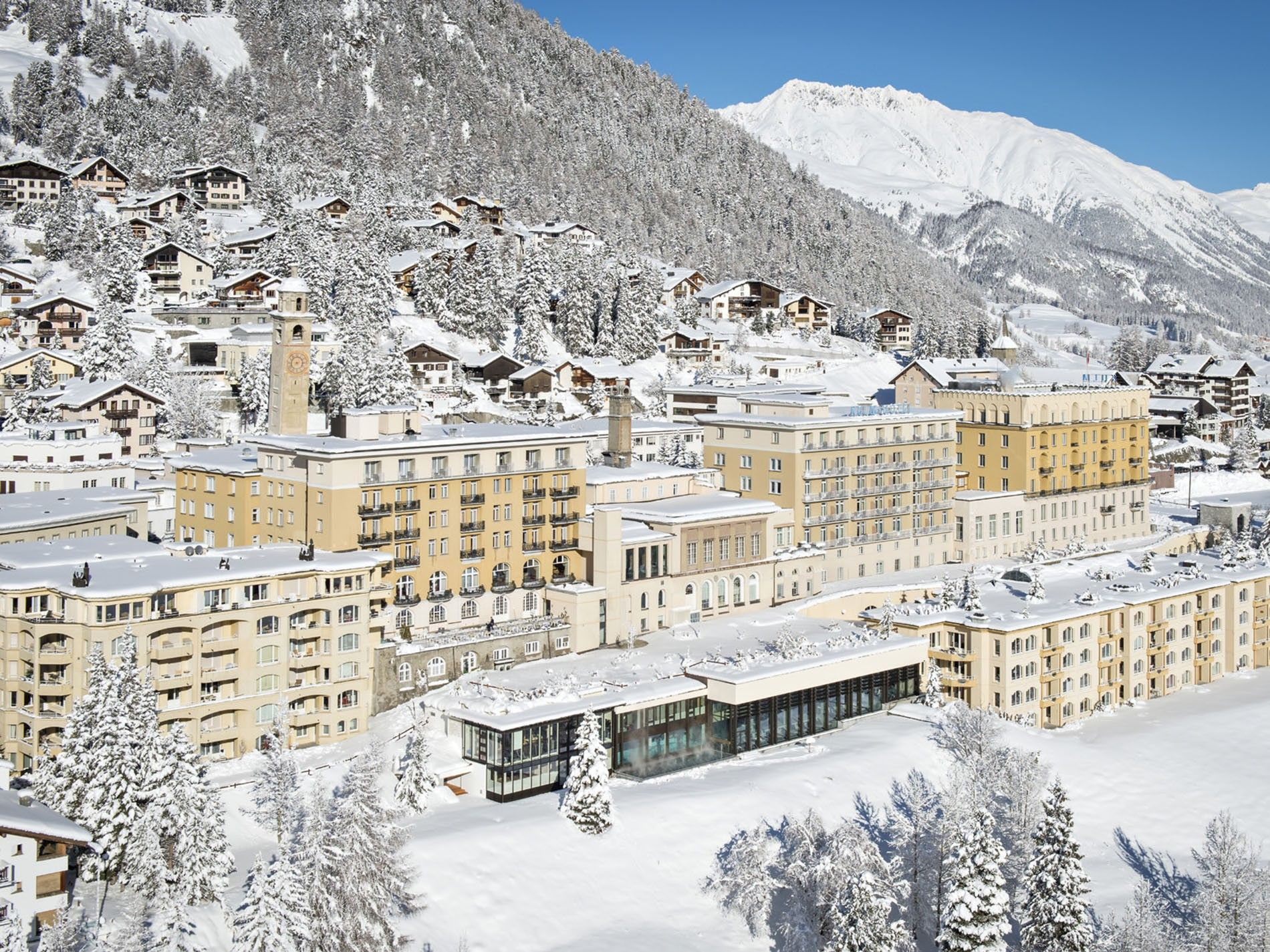 View of Kulm Hotel St. Moritz covered in snow
