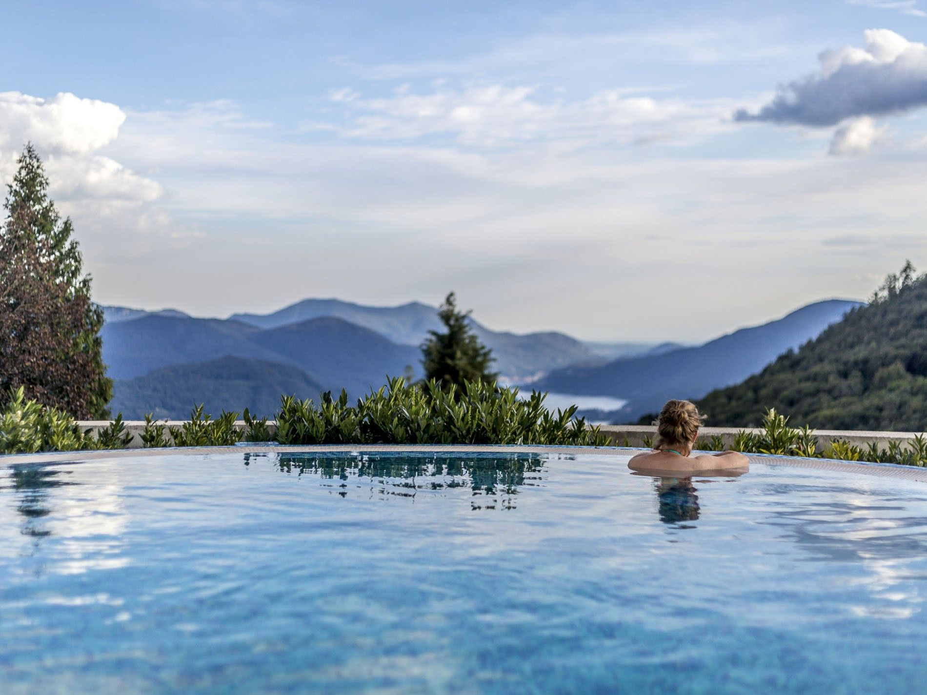 Outside pool overlooking the hills and the lake at Kurhaus Cademario Hotel and Spa