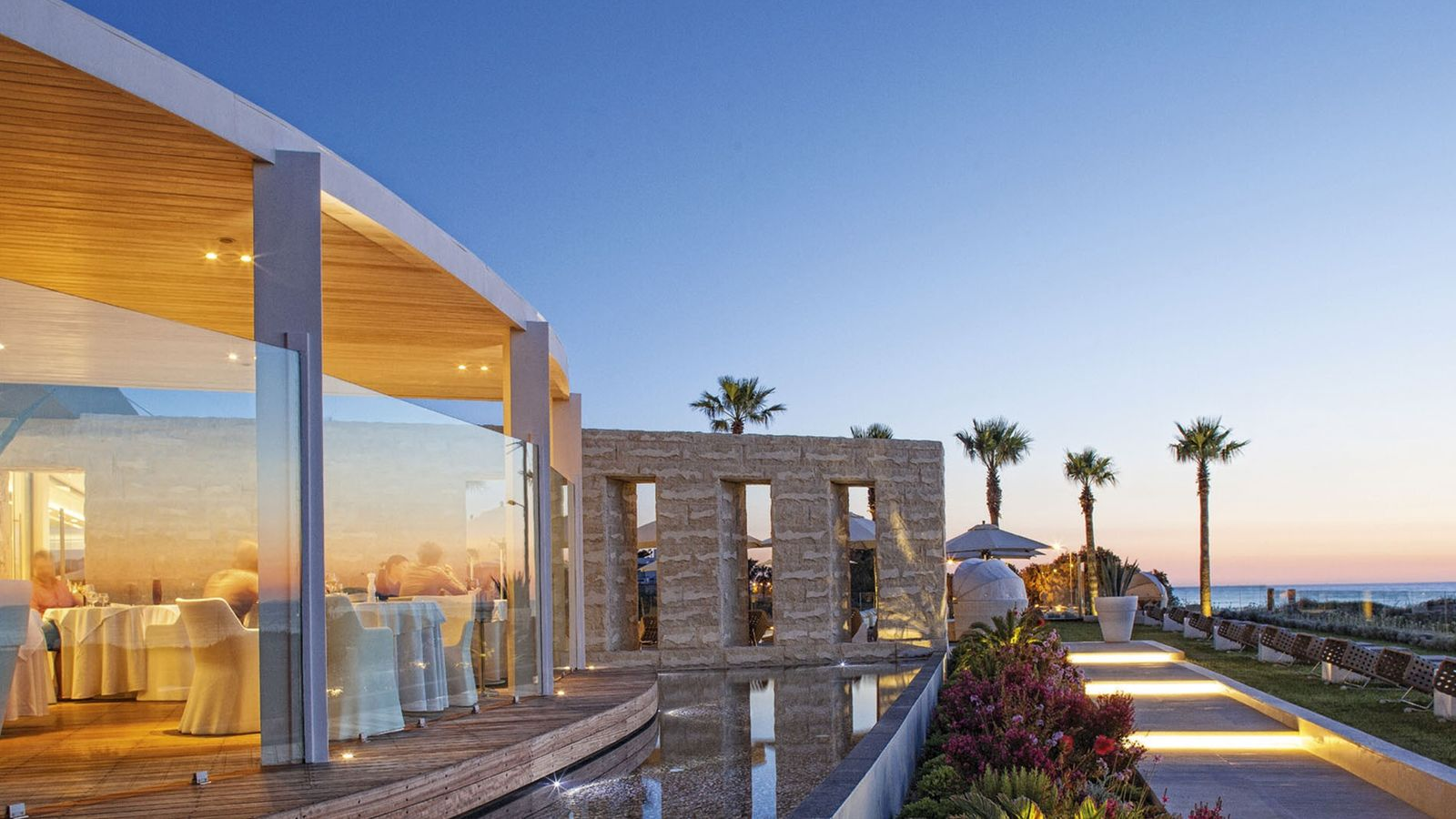 Restaurant with a view of the garden at AQUA BLU Boutique Hotel and Spa